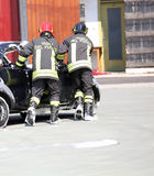 Firemen in action during the car accident Royalty Free Stock Image