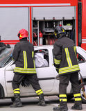 Firemen in action after the road accident Stock Images