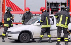 Firemen in action after the traffic accident Royalty Free Stock Images
