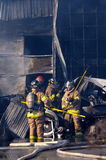 Firemen aftermath Stock Photo