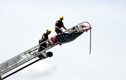 Firemen with American flag Royalty Free Stock Photos