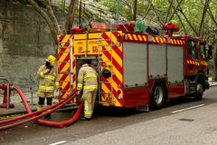 Firemen And Fire Truck Royalty Free Stock Photography