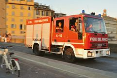 Firemen in the car going on a mission in Florence, Italy Royalty Free Stock Photos
