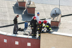 Firemen checking chimney. Stock Image