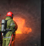 Firemen fighting the fire Stock Images