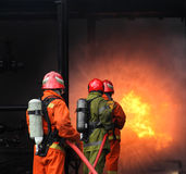 Firemen fighting the fire Royalty Free Stock Photos