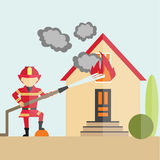 Firemen fights with fire. Firefighter spraying water with hose on the house wth flame. Rescue job Stock Images