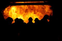 Firemen in the fire. Firemen walking in the fire Stock Photo