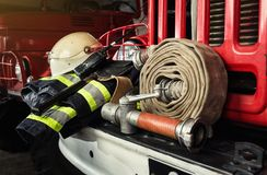 Firemen gear on firetruck such as fire barrel, special clothing, ration, helmet and hydrant royalty free stock photography
