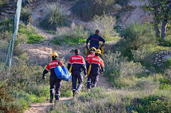 Firemen Heading Towards A Forest Fire Stock Photo