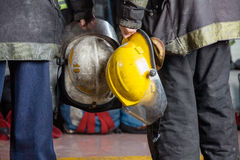 Firemen Holding Helmets At Fire Station Stock Photos
