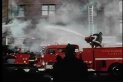 Firemen hosing burning building stock footage