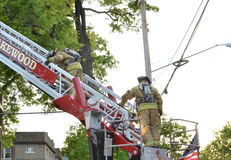 Firemen on a ladder Stock Image