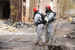 Firemen in light protective suit. Going into action Stock Image
