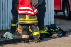 Firemen after an operation Stock Image
