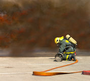 Firemen in operation surround with smoke. Royalty Free Stock Photography