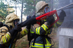 Firemen putting out fire Stock Image