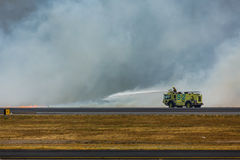 Firemen spray flames as brush fire closes San Salvador International Airport Royalty Free Stock Image