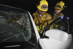 Firemen Standing By Car Royalty Free Stock Photography