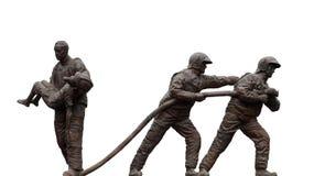 Firemen statues Stock Photos
