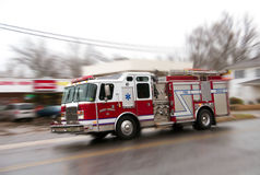 Firemen on their way to the scene. Stock Photography