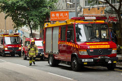 Firemen and trucks Royalty Free Stock Image