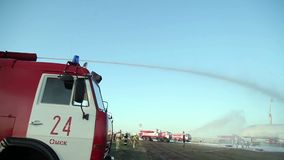 Firemen Using Water Cannon To Fight Fire stock video