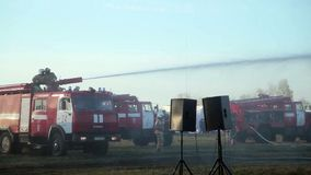 Firemen Using Water Cannon To Fight Fire stock footage