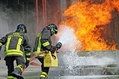 firemen who puts out the fire with a fire ex Stock Photo
