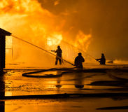 Firemen at work. On fire Stock Image