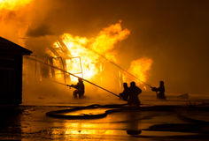 Firemen at work. On fire Stock Images
