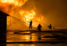 Firemen at work. On fire Royalty Free Stock Photos