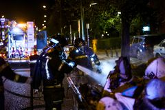 The firemen work in a night fire. Madrid Spain. stock photography