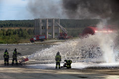 Firemens. NIZHNY TAGIL, RUSSIA- AUG 23: Demonstration of work of firemen, the fire was extinguished by the railway at the exhibition RUSSIAN DEFENCE EXPO 2012 on stock photography
