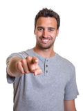 Handsome latin guy pointing at camera Stock Photos