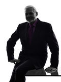 Firendly senior business man smiling silhouette Royalty Free Stock Images