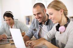 Firends websurfing on internet Stock Photos
