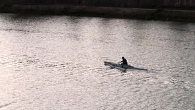 Amateurs team of rowing on the Arno river stock video footage