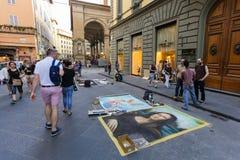 Firenze, ITALIA 11 settembre 2016: I pittori della via hanno dipinto le immagini famose del capolavoro sulla strada della via Fotografia Stock