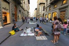 Firenze, ITALIA 11 settembre 2016: I pittori della via hanno dipinto le immagini famose del capolavoro sulla strada della via Immagine Stock Libera da Diritti