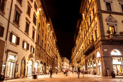 Firenze night. Night view of firenze street with people visit and shoping Stock Image