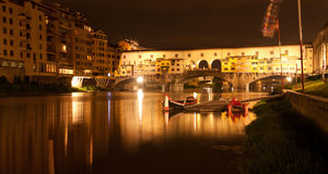 Firenze - Ponte Vecchio, Old Bridge by night, view from the rive. The Ponte Vecchio is a Medieval stone closed-spandrel segmental arch bridge over the Arno River stock photography