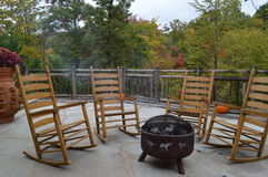 Firepit and chairs. A firepit with chairs set around it Stock Photo
