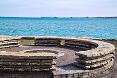 Firepit in city park with view of Michigan City, IN skyline as seen from the other side of Lake Michigan in Chicago park. Michigan City, Indiana skyline seen royalty free stock image