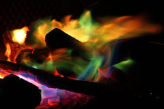 Firepit with color flames Royalty Free Stock Image