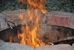 Firepit. A fire-pit ablaze in the autumn Stock Image