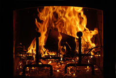 Fireplace. Fire burning in the hearth Stock Photos