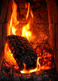 Fireplace. Roaring fire in fireplace tiled stove Stock Photography