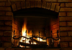 Fireplace. Beautiful and cosy brick-built fireplace Royalty Free Stock Image