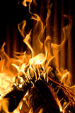 Fireplace. A fire roars in the fireplace Royalty Free Stock Photos
